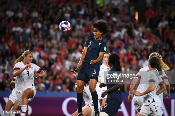 France's defender Wendie Renard scores her team's first goal during the France 2019 Women's World Cup quarterfinal football match between France and...
