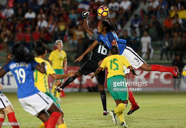 France's defender Wendie Renard vies for the ball with South Africa's players during the friendly football match between France and South Africa on...