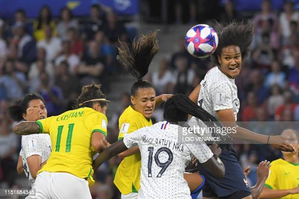 TOPSHOT France's defender Wendie Renard vies with Brazil's forward Cristiane during the France 2019 Women's World Cup round of sixteen football match...