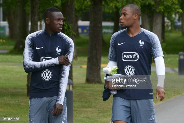 France's defenders Benjamin Mendy and Djibril Sidibe arrive a training session at the French national football team centre in...