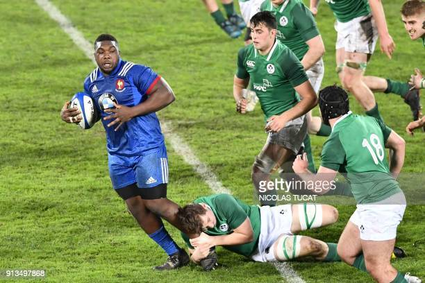 France's Demba Bamba vies with Ireland's players during the Six Nations U20 rugby match France versus Ireland on February 2 2018 at the ChabanDelmas...