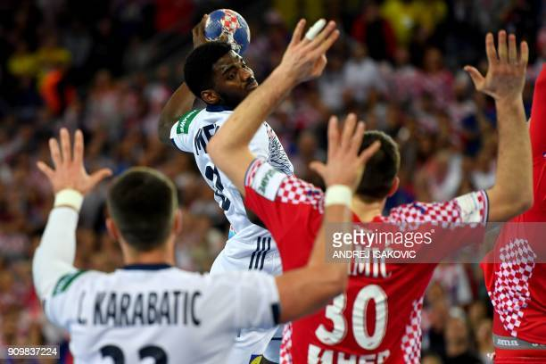 TOPSHOT France's Dika Mem shoots over Croatia's Marko Mamic during the group I match of the Men's 2018 EHF European Handball Championship between...