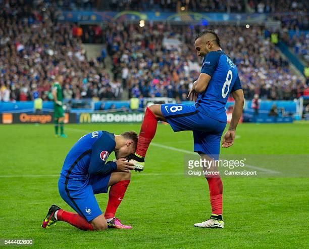 France's Dimitri Payet celebrates scoring his sides third goal as team mate Antoine Griezmann kisses his boot during the UEFA Euro 2016 Quarterfinal...