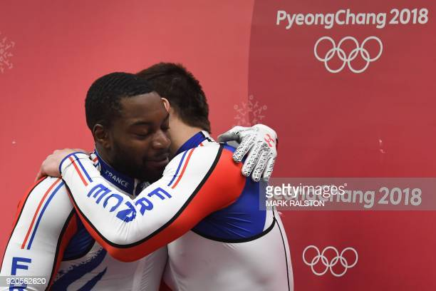 TOPSHOT France's Dorian Hauterville and Romain Heinrich celebrate at the end of the 2man bobsleigh heat 4 final run during the Pyeongchang 2018...