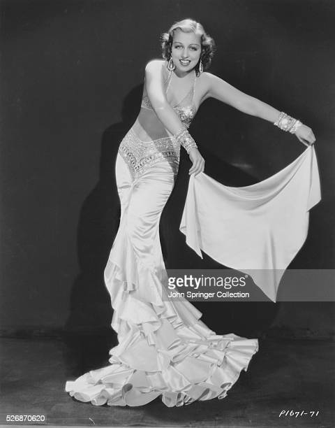 Frances Drake in a Silk Evening Gown
