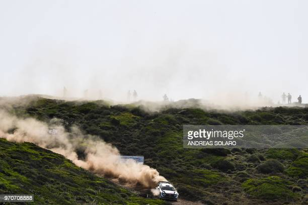 TOPSHOT France's driver Sebastien Ogier and codriver Julien Ingrassia drive their Ford Fiesta WRC during the 2018 FIA World Rally Championship on...