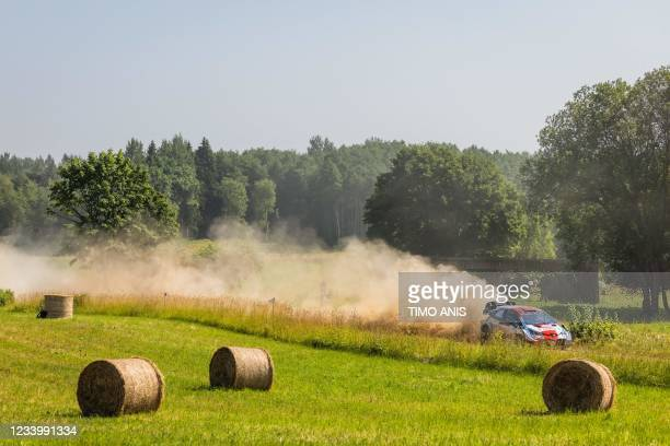 France's driver Sebastien Oguier and France's co-driver Julien Ingrassia steer their Toyota Yaris WRC car during the Shakedown Rally Start of the FIA...