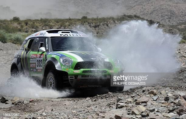 France's driver Stephane Peterhansel steers his Mini during the Stage 3 of the 2012 Dakar between San Rafael Mendoza province and San Juan San Juan...