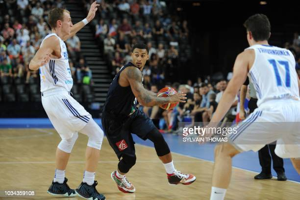 France's Edwin Jackson fights for the ball with Finland's Alexander Murphy during the 2019 FIBA Basketball World Championship European qualifying...