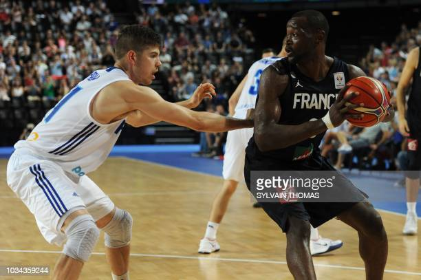 France's Edwin Jackson fights for the ball with Finland's Shawn Huff during the 2019 FIBA Basketball World Championship European qualifying group...