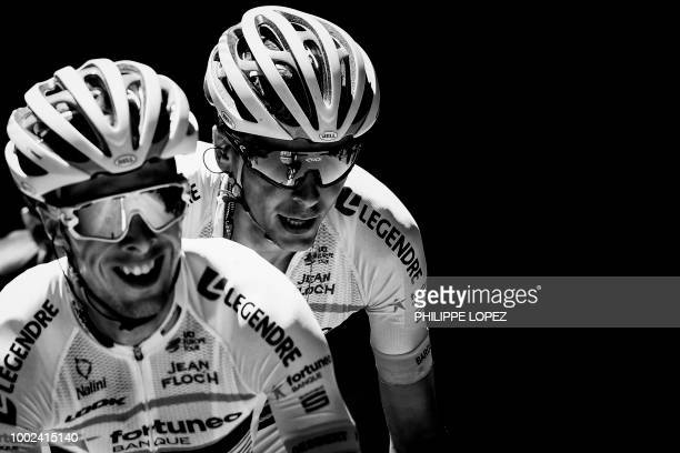 France's Elie Gesbert and France's Warren Barguil ride during their breakaway in the twelfth stage of the 105th edition of the Tour de France cycling...
