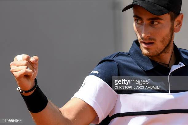 France's Elliot Benchetrit celebrates after winning against Britain's Cameron Norrie at the end of their men's singles first round match on day three...