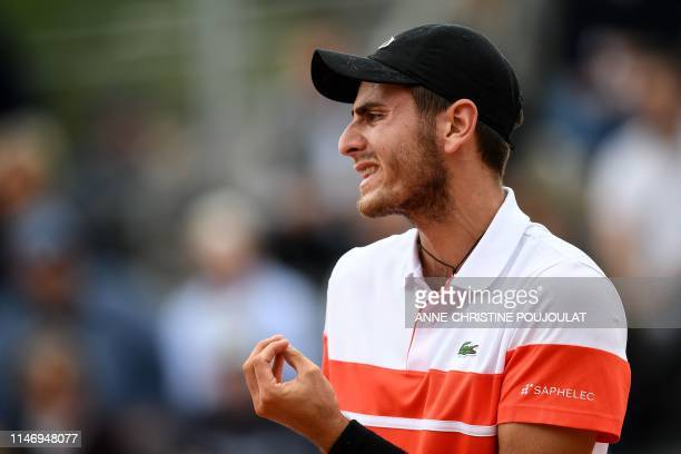 France's Elliot Benchetrit reacts during his men's singles second round match against Serbia's Dusan Lajovic on day five of The Roland Garros 2019...