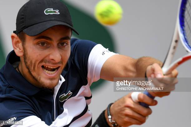 France's Elliot Benchetrit returns the ball to Britain's Cameron Norrie during their men's singles first round match on day three of The Roland...