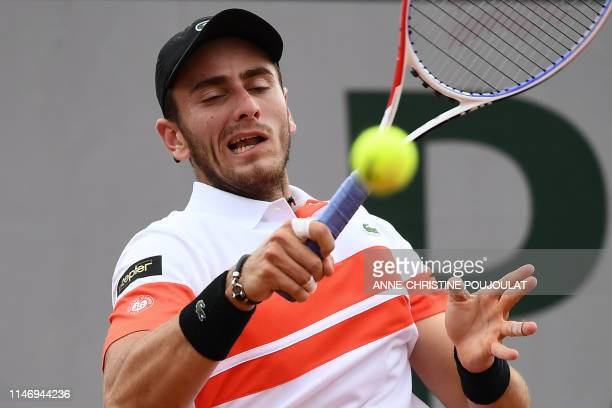France's Elliot Benchetrit returns the ball to Serbia's Dusan Lajovic during their men's singles second round match on day five of The Roland Garros...