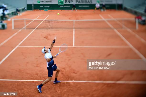 France's Elliot Benchetrit serves the ball to John Isner of the US during their men's singles first round tennis match on Day 1 of The Roland Garros...
