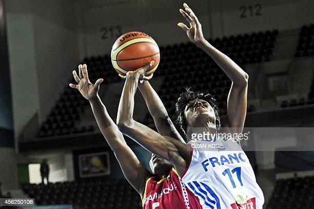 France`s Emilie Gomis vies for the ball with Mozambican Ana Flavia de Azinherira during the 2014 FIBA World Championship match between France and...