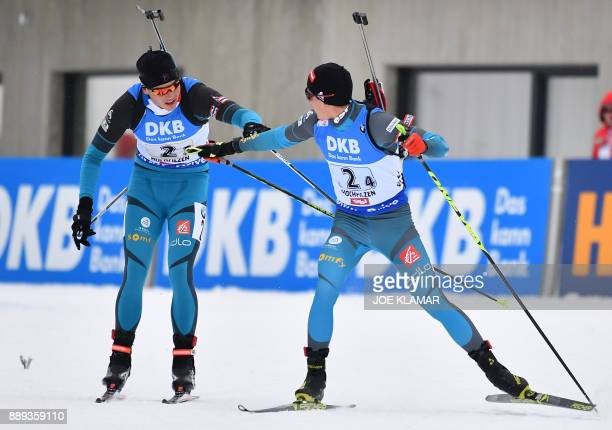France's Emilien Jacquelin and Quentin Fillon Maillet compete during the men's 4x75 km relay event at the IBU World Cup Biathlon in Hochfilzen...