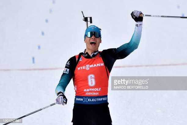 France's Emilien Jacquelin celebrates as he crosses the finish line to win the IBU Biathlon World Cup 12.5 km Men's pursuit in Rasen-Antholz ,...