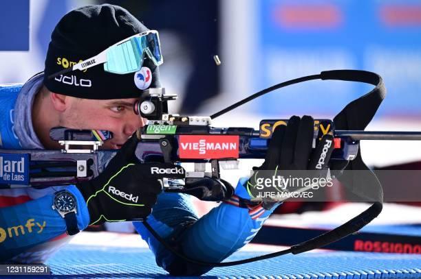 France's Emilien Jacquelin competes at the shooting range the Men's 12,5 km Pursuit event at the IBU Biathlon World Championships in Pokljuka,...