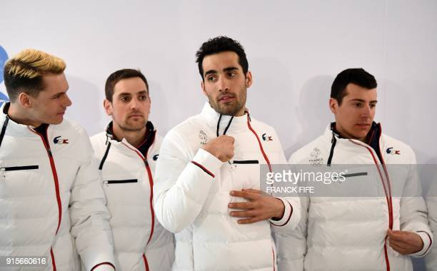 France's Emilien Jacquelin Simon Desthieux France's Martin Fourcade France's flag bearer at the 2018 Pyeongchang Winter Olympics and France's Quentin...