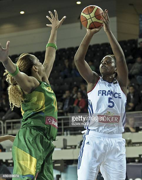 France's Endere Miyem vies with Brazil's Clarissa Santos during the 2014 FIBA World Championship basketball match between France and Brazil at Ankara...