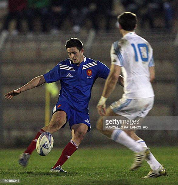 France's Enzo Selponi is tackeled by Italian Edoardo PAdovani during their their 6 NationS Rugby Under 20 match at Tomaselli Stadium on February 1...