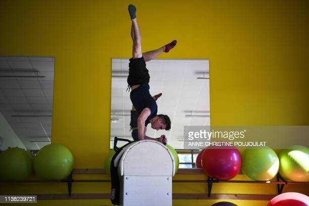 France's equestrian vaulter Clement Taillez warms up before the FEI Vaulting World Cup final competition on April 19, 2019 in the Ecole Nationale...