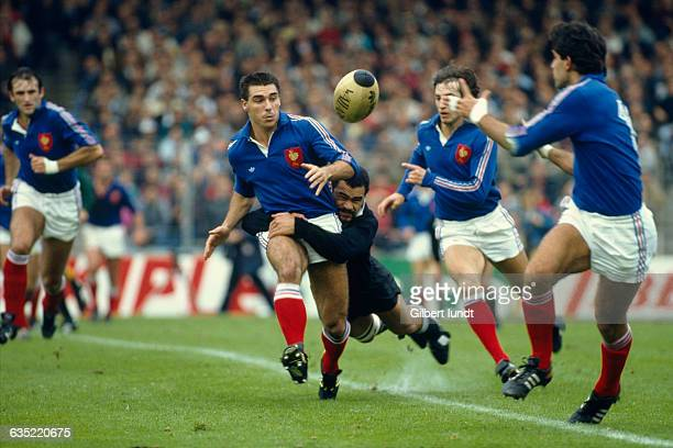 France's Eric Bonneval is tackled by New Zealand's Joe Stanley during a Rugby Union Test Match France vs New Zealand