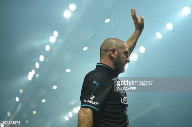 France's Eric Cantona waves after an England V Soccer Aid World XI charity football match for Soccer Aid for Unicef at Old Trafford in Manchester...