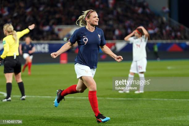 France's Eugenie Le Sommer celebrates after scoring goal against Japan during women friendly soccer match France vs Japan at Stade de L'AbbeDeschamps...