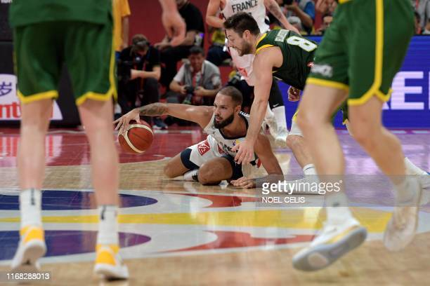 France's Evan Fournier fights for the ball with Australia's Matthew Dellavedova during the Basketball World Cup third place game between France and...