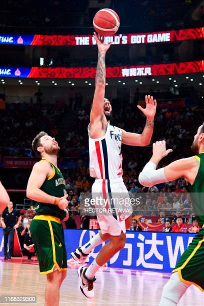 France's Evan Fournier goes for a basket during the Basketball World Cup third place game between France and Australia in Beijing on September 15 2019