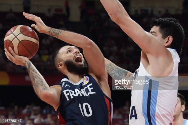 TOPSHOT France's Evan Fournier goes to the basket as Argentina's Gabriel Deck tries to block during the Basketball World Cup semifinal game between...