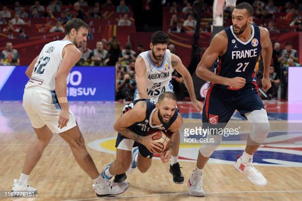 TOPSHOT France's Evan Fournier handles the ball during the Basketball World Cup semifinal game between Argentina and France in Beijing on September...