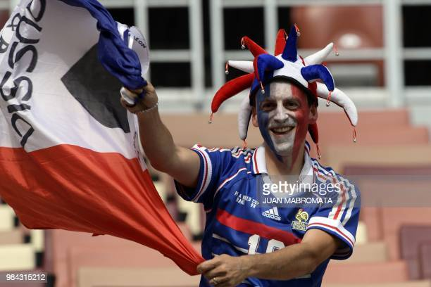 A France's fan poses with a national flag before the Russia 2018 World Cup Group C football match between Denmark and France at the Luzhniki Stadium...