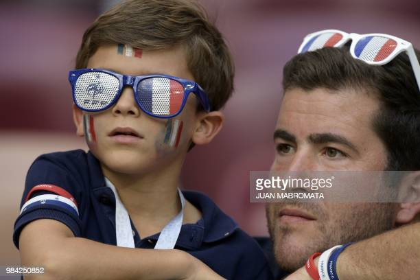 France's fans look on as they wait before the Russia 2018 World Cup Group C football match between Denmark and France at the Luzhniki Stadium in...