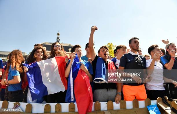 France's fans react as they watch on a giant screen the Russia 2018 World Cup Group C football match between Denmark and France at a fan zone set up...