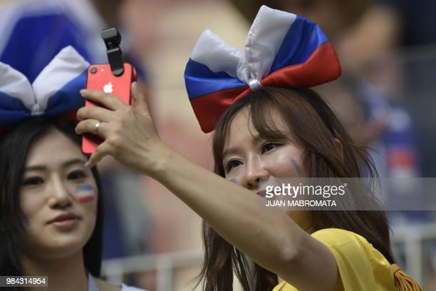 France's fans take a selfie before the Russia 2018 World Cup Group C football match between Denmark and France at the Luzhniki Stadium in Moscow on...