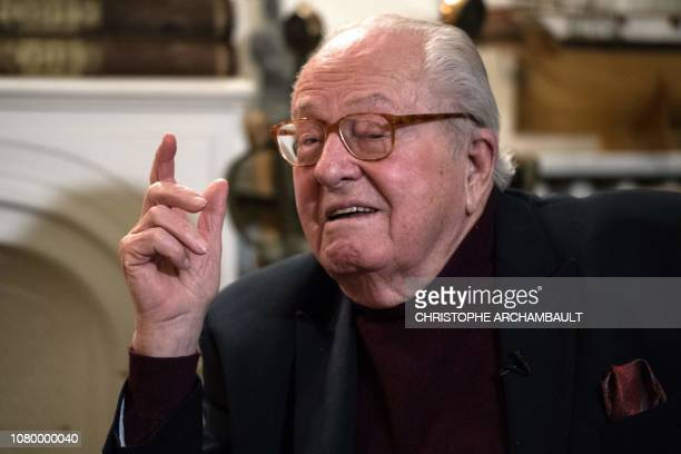 France's farright Front National party founder and former leader JeanMarie Le Pen gestures as he speaks during an interview at his house in...