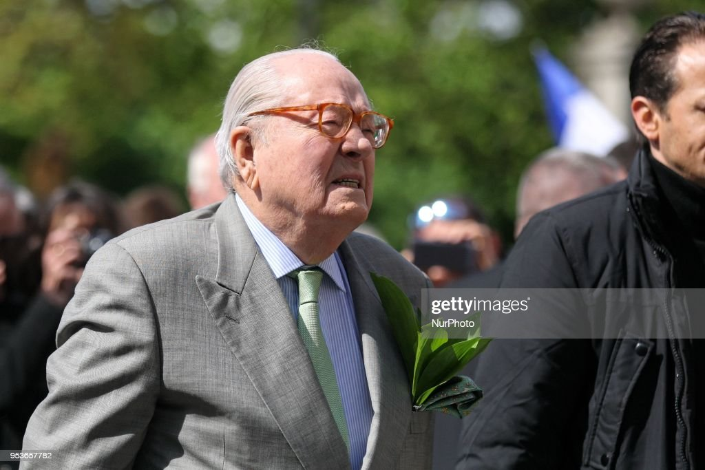 France's far-right Front National (FN) party founder and former leader Jean-Marie Le Pen (C) attendS the annual rally in honor of Jeanne d'Arc (Joan of Arc) at the Place des Pyramides in Paris on May 1, 2018. Jean-Marie Le Pen, the firebrand co-founder of France's far-right National Front who was eventually kicked out of the party by his daughter, confirmed he was now a member of the Alliance for Peace and Freedom (APF), a grouping of European far-right parties, which said the octogenarian had joined on March 22, 2018.
