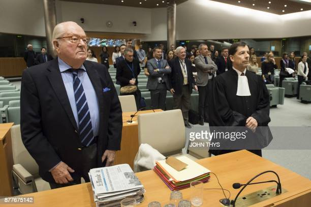 France's farright National Front honorary president JeanMarie Le Pen stands next to his lawyer Francois Wagner as he appears before the Court of...