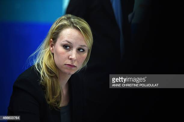 France's farright National Front party MP Marion Marechal Le Pen attends a press conference on March 17 2015 in Le Pontet southern France ahead of...