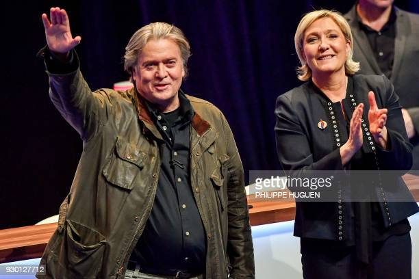 TOPSHOT France's farright party Front National president Marine Le Pen applauds former US President advisor Steve Bannon after his speech during the...
