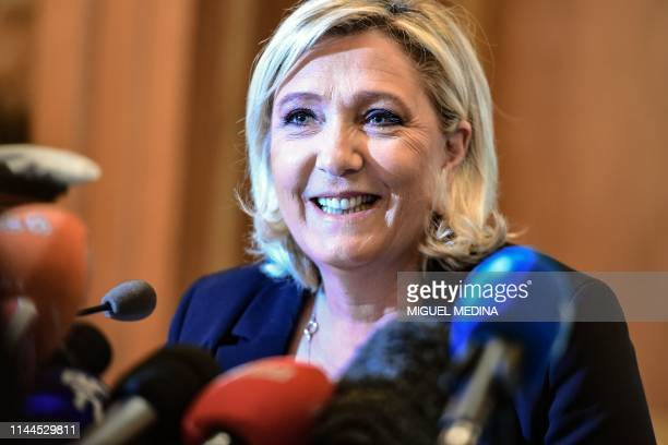 France's farright party Rassemblement National president Marine Le Pen smiles during a press conference on May 18 2019 in Milan where they came to...