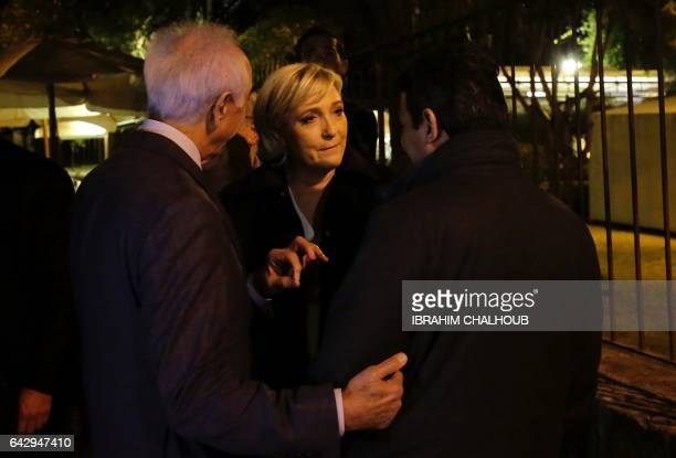 France's farright presidential candidate Marine Le Pen chats with people before a attending a dinner in the Lebanese coastal city of Byblos north of...