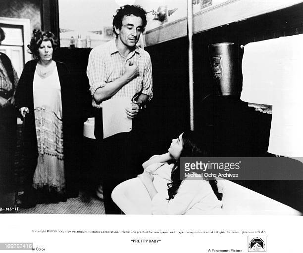 Frances Faye watches as director Louis Malle coaches Brooke Shields on set of the film 'Pretty Baby' 1978