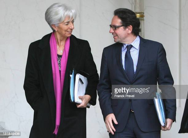 France's Finance and Economy Minister Christine Lagarde and France's Transport Junior Minister Frederic Lefebvre leave the weekly cabinet meeting at...