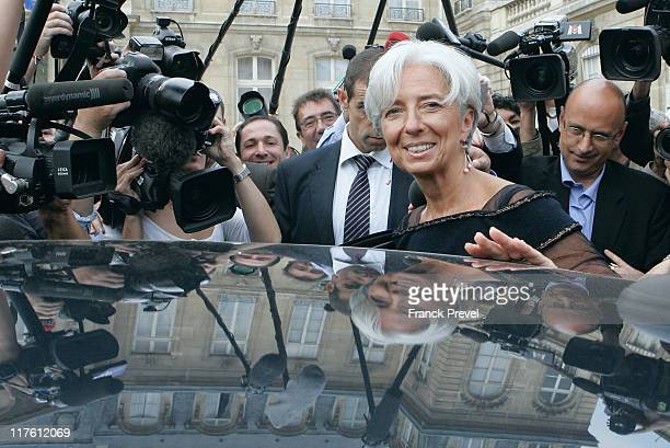 France's Finance and Economy Minister Christine Lagarde is surrounded by the media as she leaves the weekly cabinet meeting at Elysee Palace on June...