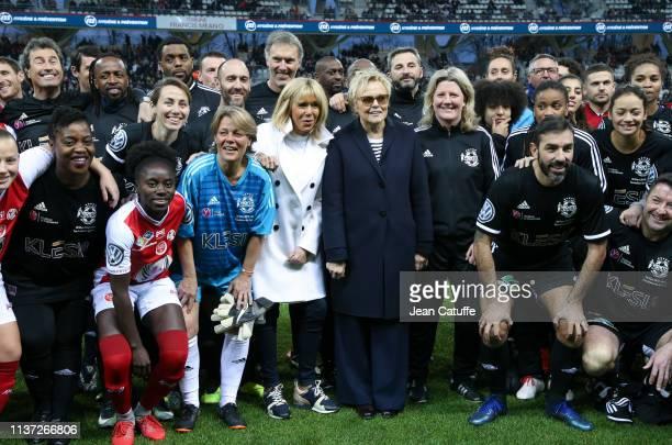 France's First Lady Brigitte Macron Muriel Robin among Claudia Tagbo Omar Da Fonseca Sidney Govou Frederic Piquionne JeanMichel Lesage Laurent Blanc...